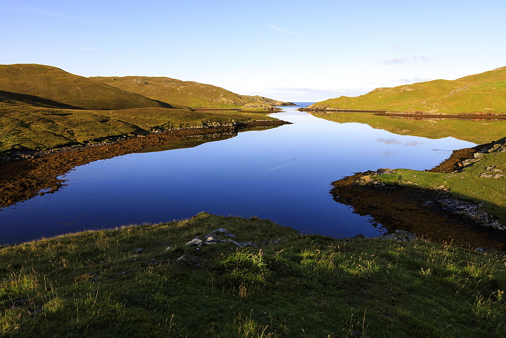 Mavis Grind, early morning reflections, narrow isthmus between North Sea and Atlantic Ocean, Shetland Isles, Scotland, United Kingdom, Europe, Europe