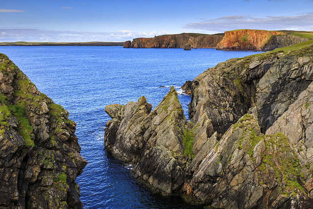 Ness of Hillswick, dramatic jagged cliffs, and red granite cliffs of The Heads of Grocken, Northmavine, Shetland Isles, Scotland, United Kingdom, Europe