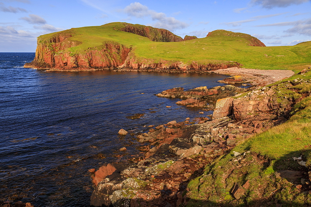 North Ham Bay, deep inlet, lichen covered huge red granite cliffs, Muckle Roe Island, Shetland Isles, Scotland, United Kingdom, Europe