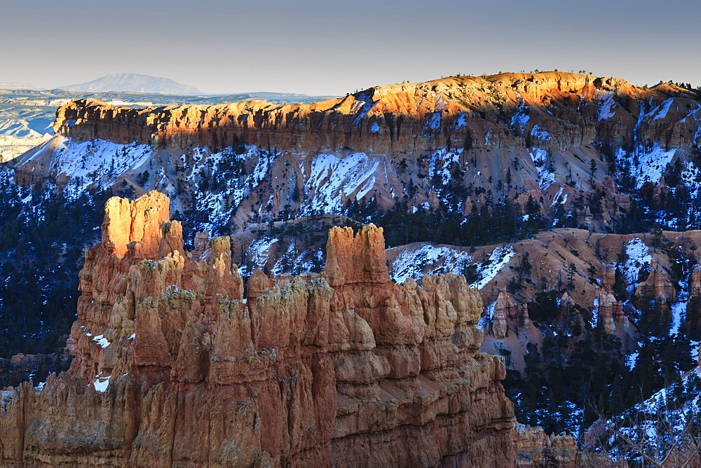 Rocks lit by late afternoon sun with snow, from Sunset Point, Bryce Canyon National Park, Utah, United States of America, North America
