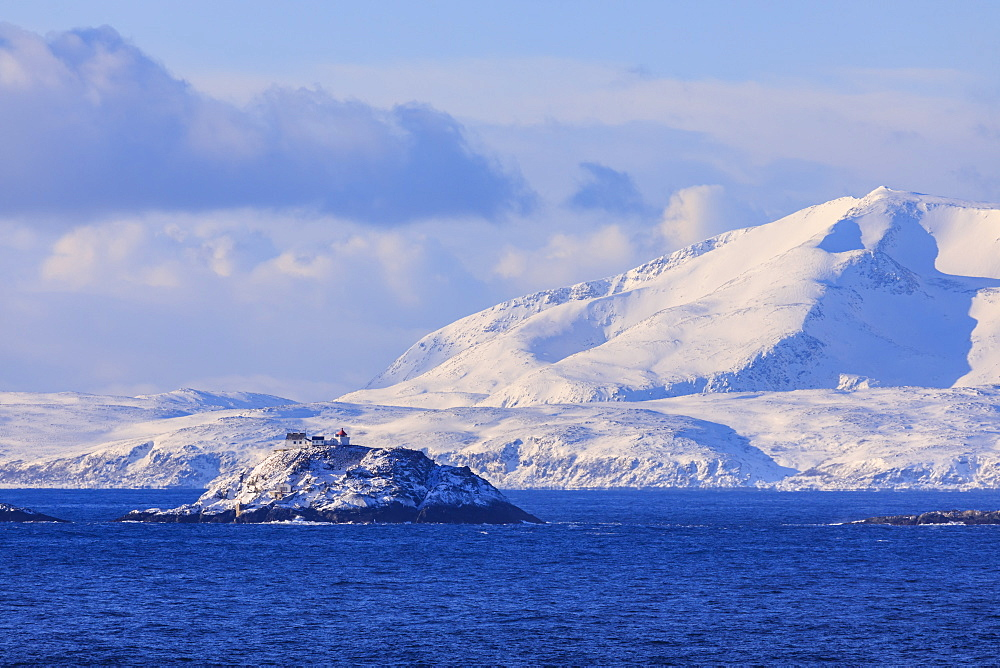 Lighthouse, Norwegian Sea, spectacular snow covered mountains in winter, Troms islands, Arctic Circle, North Norway, Europe