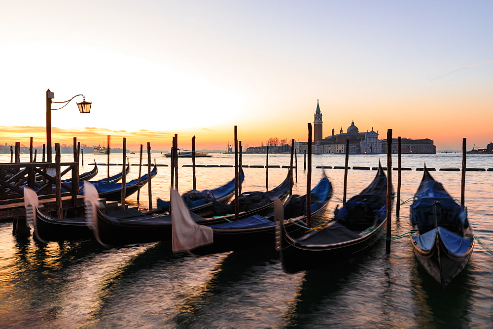 Beautiful Venetian sunrise in winter, gondolas, San Giorgio Maggiore and Lido, Venice, UNESCO World Heritage Site, Veneto, Italy, Europe