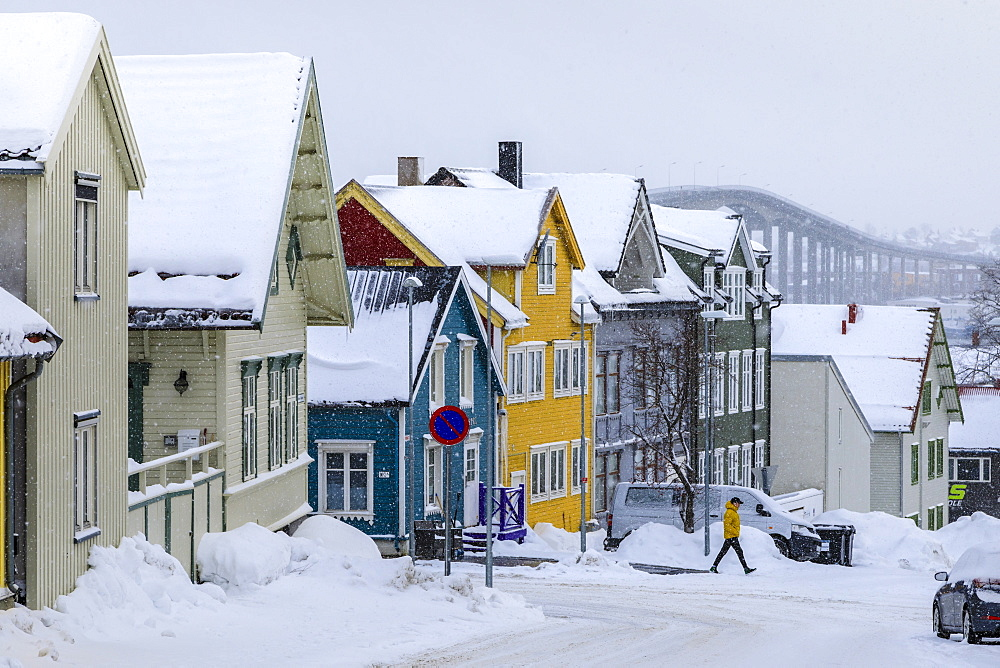 Historic colourful wooden houses, Bridge, heavy snow in winter, Tromso, Troms og Finnmark, Arctic Circle, North Norway, Scandinavia, Europe