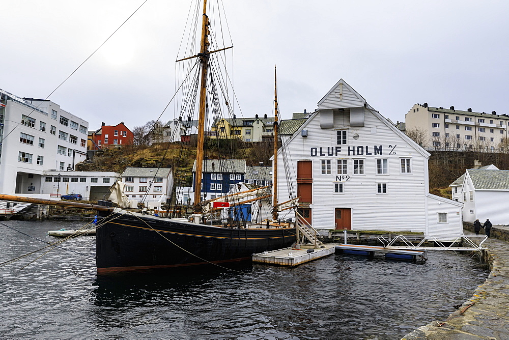 Beautiful Alesund, waterfront, historic boat, wooden warehouse in winter, Alesund, More og Romsdal, Norway, Scandinavia, Europe