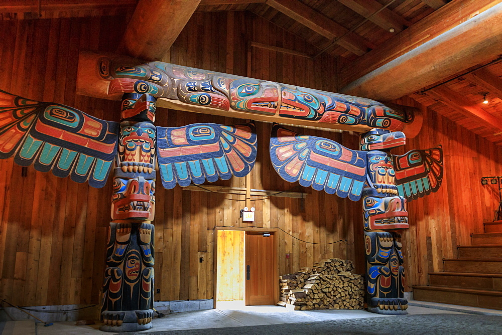 Carved totems, The Big House, Klemtu, First Nations Kitasoo Xai Xais community, Great Bear Rainforest, British Columbia, Canada, North America