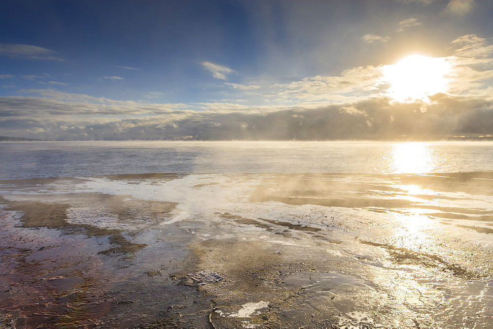 Freezing dawn mists, Yellowstone Lake at West Thumb Geyser Basin, Yellowstone National Park, UNESCO World Heritage Site, Wyoming, United States of America, North America