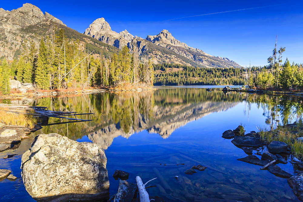 Reflections of the Teton Range in Taggart Lake, Grand Teton National Park, Wyoming, United States of America, North America