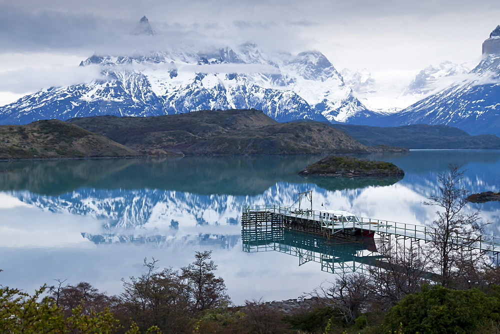 Boatdock and late evenng reflections in Lago Pehoe, Torres del Paine National Park, Patagonia, Chile, South America