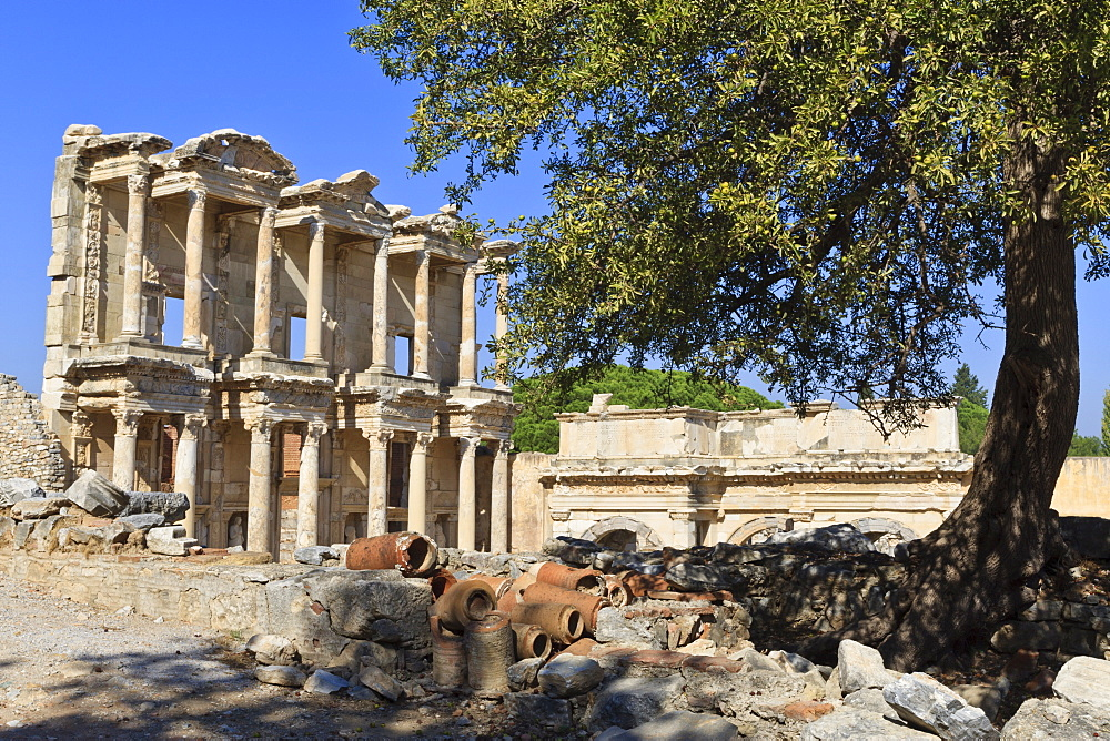 Facade of the Library of Celsus, fruit tree and ancient pipes, ancient Ephesus, near Kusadasi, Anatolia, Turkey, Asia Minor, Eurasia
