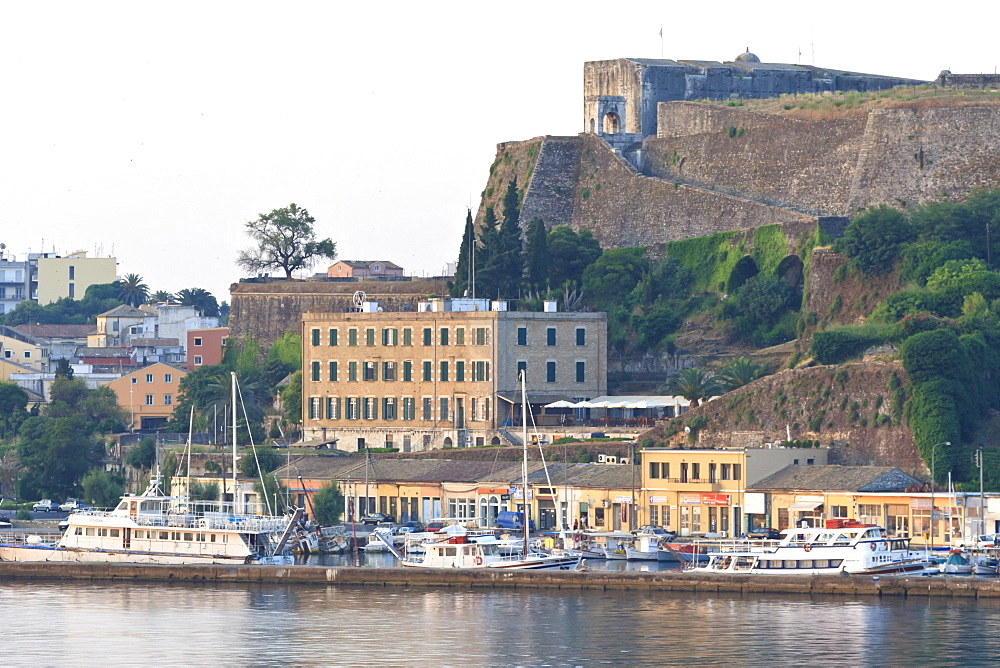 Summer dawn, Corfu Town  fortifications and harbour from the sea, UNESCO World Heritage Site, Corfu, Ionian Islands, Greek Islands, Greece, Europe