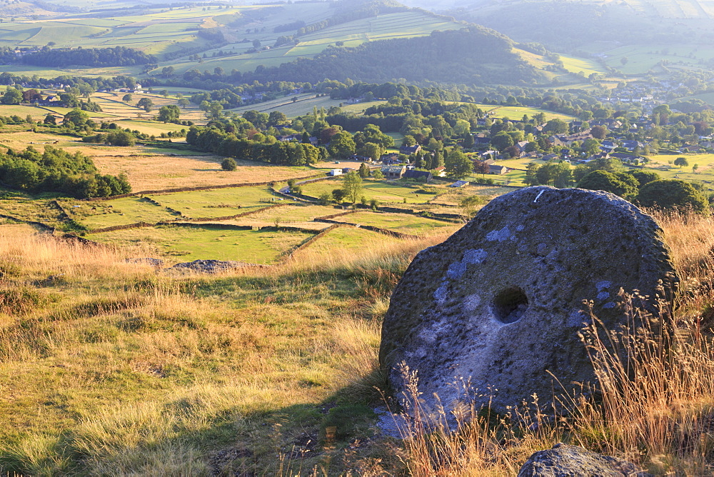 Millstone and golden fields above Curbar in summer, Curbar Edge, Peak District National Park, Derbyshire, England, United Kingdom, Europe