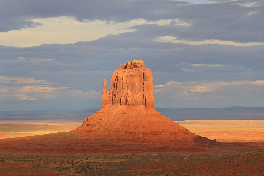 Mitten at dusk lit by late evening sun, Monument Valley Navajo Tribal Park, Utah Arizona border, United States of America, North America