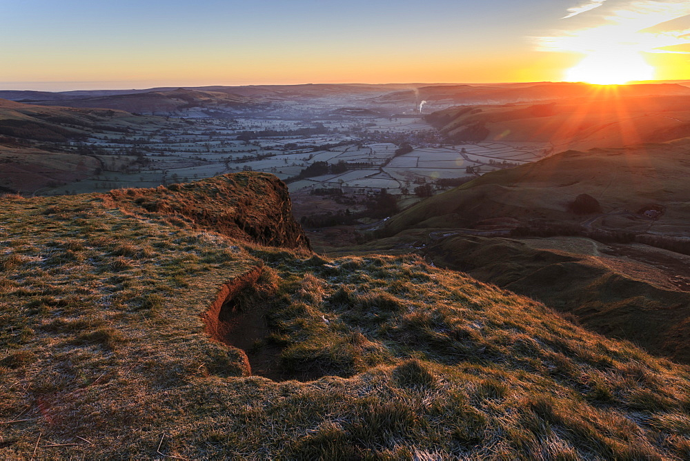 Mam Tor (Shivering Mountain), exposed east face strata lit by rising sun in winter, Castleton, Peak District, Derbyshire, England, United Kingdom, Europe