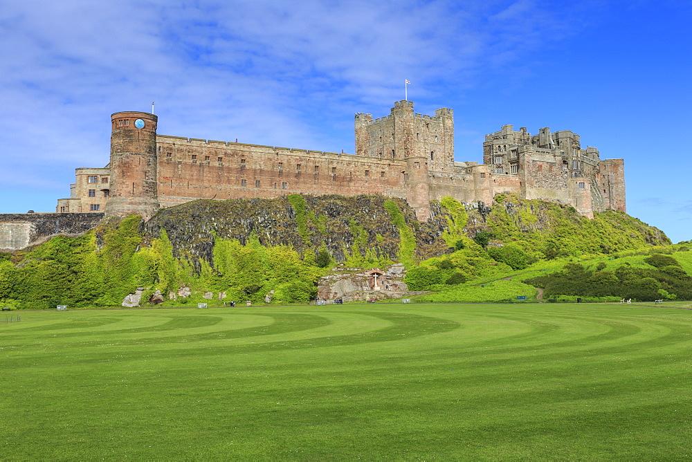 Bamburgh Castle under a blue summer sky, Bamburgh, Northumberland, England, United Kingdom, Europe