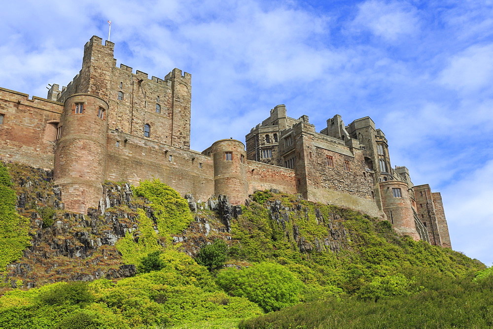 Bamburgh Cast in summer, from below, Northumberland, England, United Kingdom, Europe