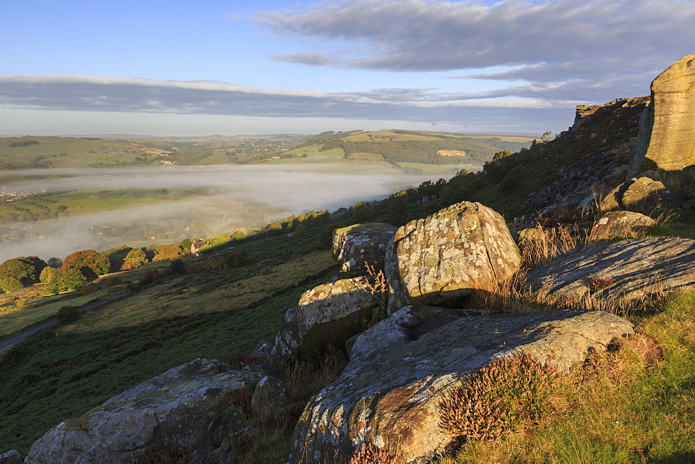 Mist clears from valley, fields and woods, from Curbar Edge at sunrise, autumn dawn, Peak District, Derbyshire, England, United Kingdom, Europe