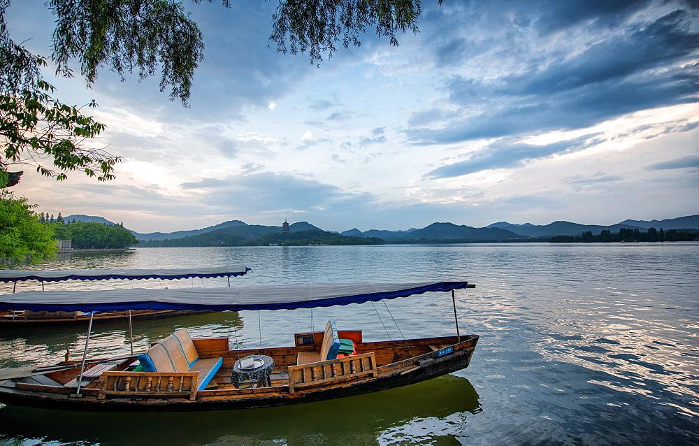 Boats at West Lake shore in Hangzhou, Zhejiang, China, Asia
