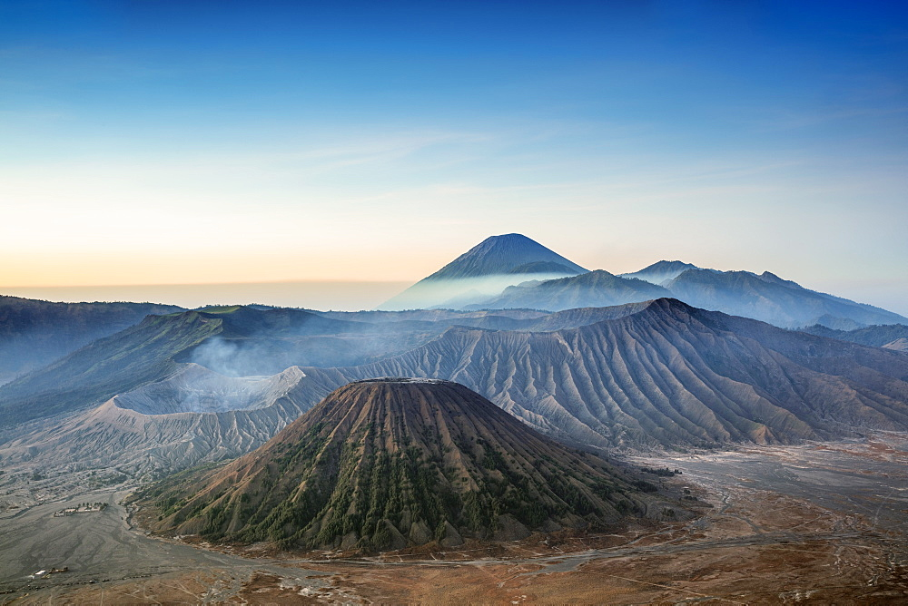 Indonesia, Java, view out over volcanic peaks and lava landscapes around Mount Bromo at dawn - 1176-1005