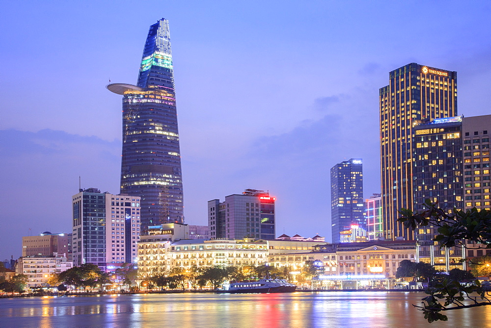 The skyline of the Central Business District of Ho Chi Minh City showing the Bitexco tower and the Saigon river