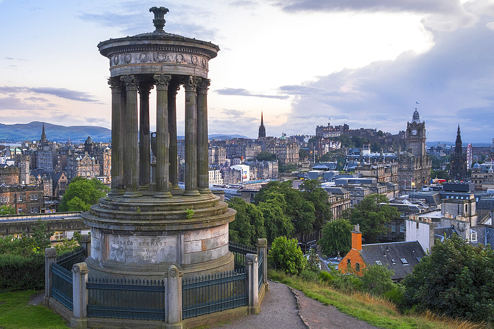 The Dugald Stewart monument on Calton Hill, Edinburgh with the city skyline in the background, Edinburgh, Scotland, United Kingdom, Europe