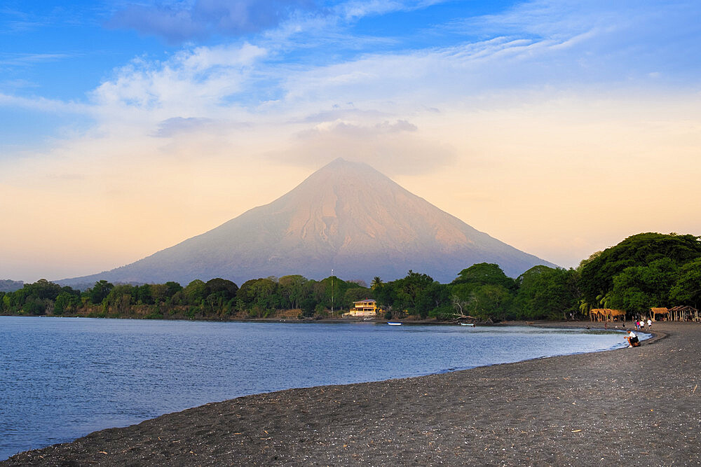 The peak of Concepcion volcano and a black sand beach on Ometepe Island, Lake Nicaragua, Nicaragua