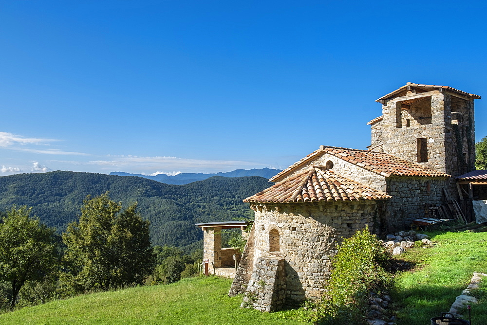 Europe, Spain, Catalonia, Pyrenees. Sant Marti de Toralles Norman church and the Garrotxa Volcanic Zone Natural Park