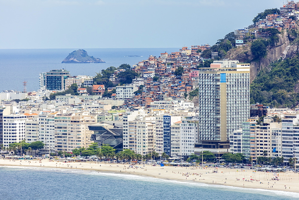 Elevated view of Copacabana Beach, apartment blocks and the Pavao Pavaozinhao favela slum, Rio de Janeiro, Brazil, South America