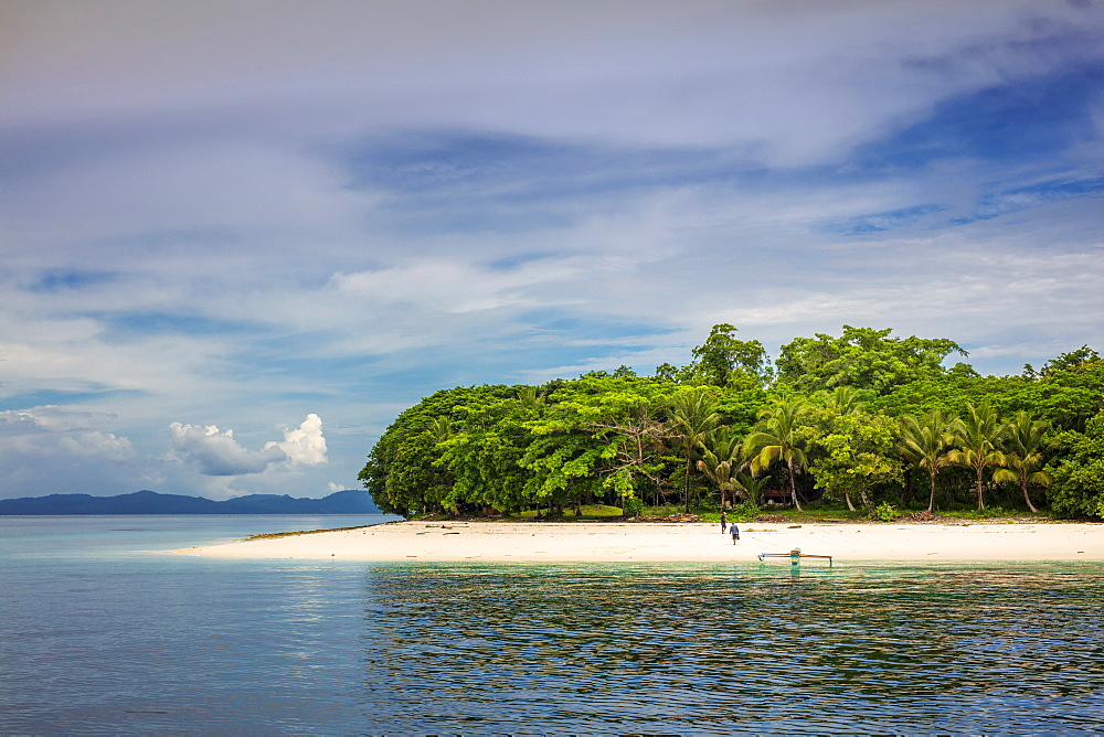 Indonesia, Spice Islands, Ambon, Pulau Molana island. An outrigger canoe on a deserted beach