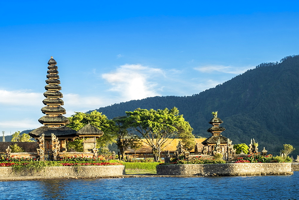 Indonesia, Bali, Lake Bratan. The Pura Bratan Hindau Shiva temple next to Catur volcano on the shore of Bratan Lake