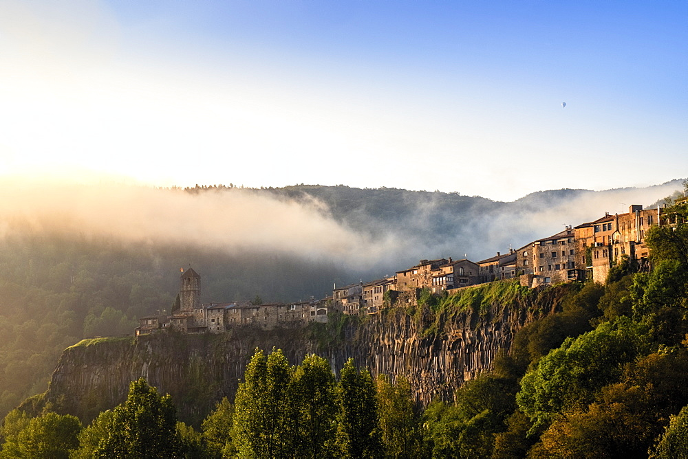The clifftop village of Castellfollit de la Roca in the morning light, Garrotxa, Girona, Catalonia, Spain, Europe - 1176-1173