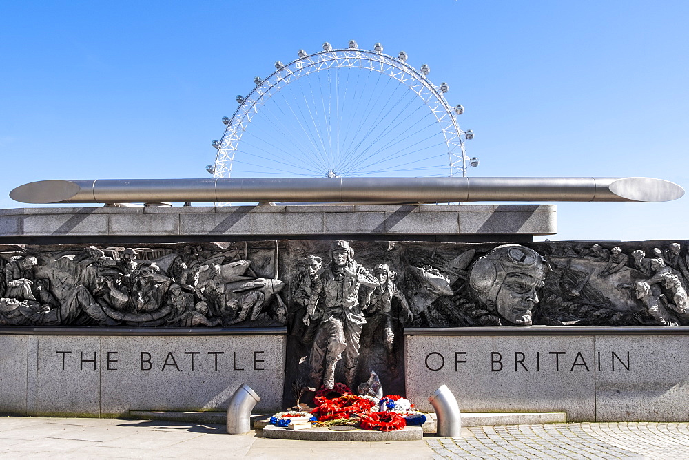 The RAF Battle of Britain Memorial Monument by British sculptor Paul Day, with the London Eye behind, London, England, United Kingdom, Europe