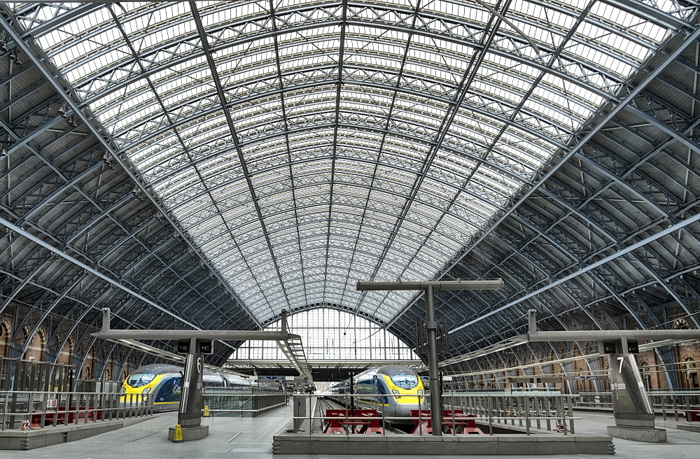 Eurostar Trains waiting on platforms in the 19th century wrought iron interior of St. Pancras Railway station, London, England, United Kingdom, Europe