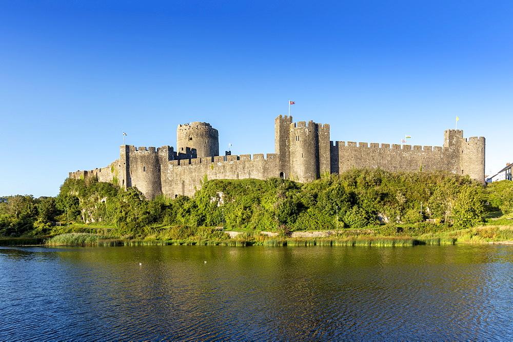 UK, Wales, Pembrokeshire, Pembroke. Medieval walls of Pembroke Castle (Castell Penfro), birthplace of King Henry VII of England