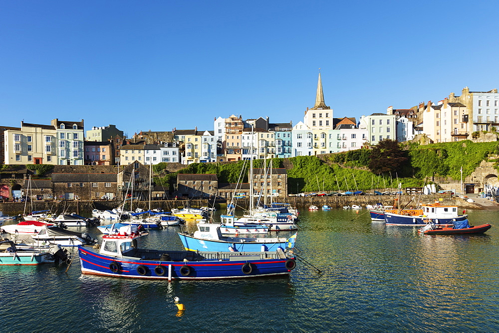 United Kingdom, Wales, Pembrokeshire, Tenby. View of the town centre and fishing boats in the harbour