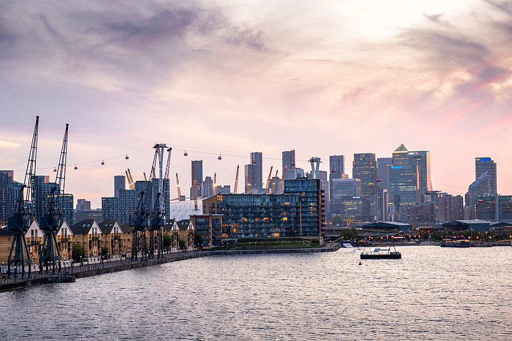 London skyline with Canary Wharf financial district, the O2 Centre Millennium Dome, Emirates Cable Car and Victoria Dock, London, England, United Kingdom, Europe - 1176-1355