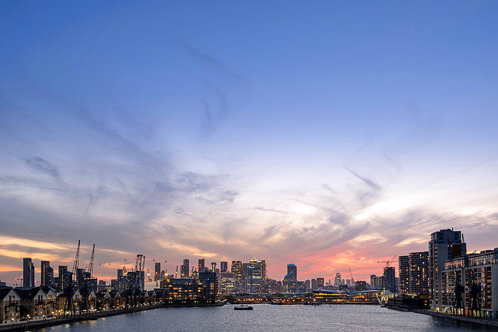 London skyline at dusk with Canary Wharf and the City of London financial districts, the Emirates Cable Car and Victoria Dock, London, England, United Kingdom, Europe - 1176-1357