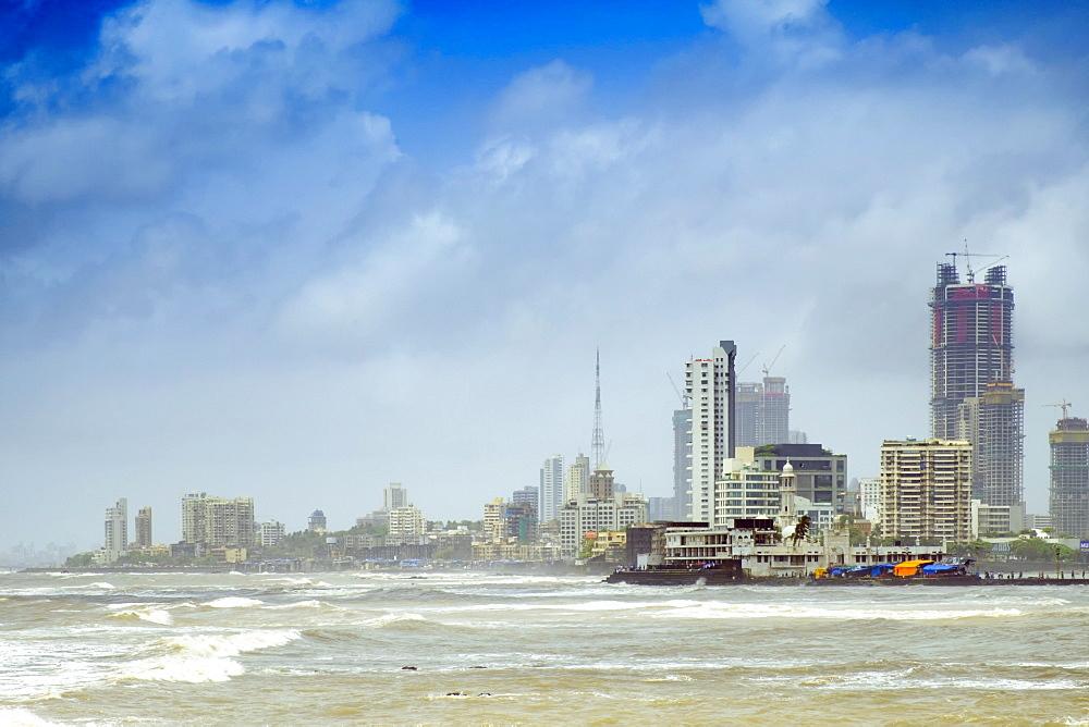 The Haji Ali mosque and the skyline of central Mumbai under monsoon seas, Mumbai (Bombay), Maharashtra, India, Asia