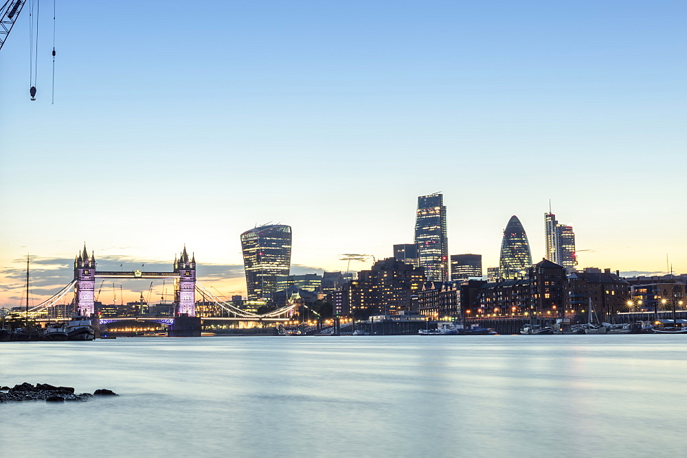Skyline of the City of London and Tower Bridge at twilight shot from Bermondsey, London, England, United Kingdom, Europe