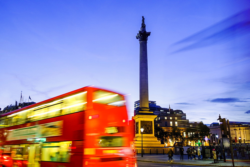 Red bus passing Nelson's Column in Trafalgar Square, London, England, United Kingdom, Europe