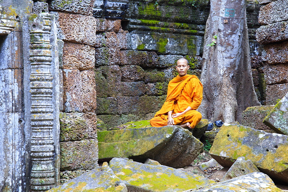 Buddhist monk sitting in a ruined temple in Angkor - 1176-925