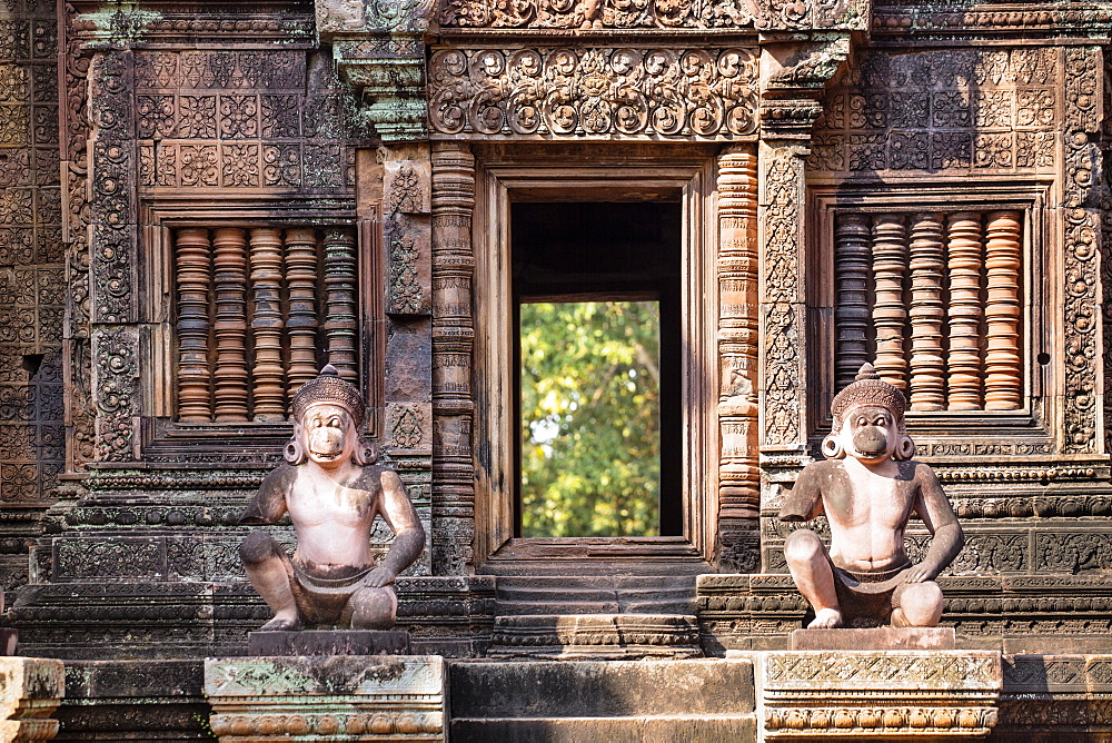 Detailed carving on the facade of a temple at Banteay Srei in Angkor - 1176-941