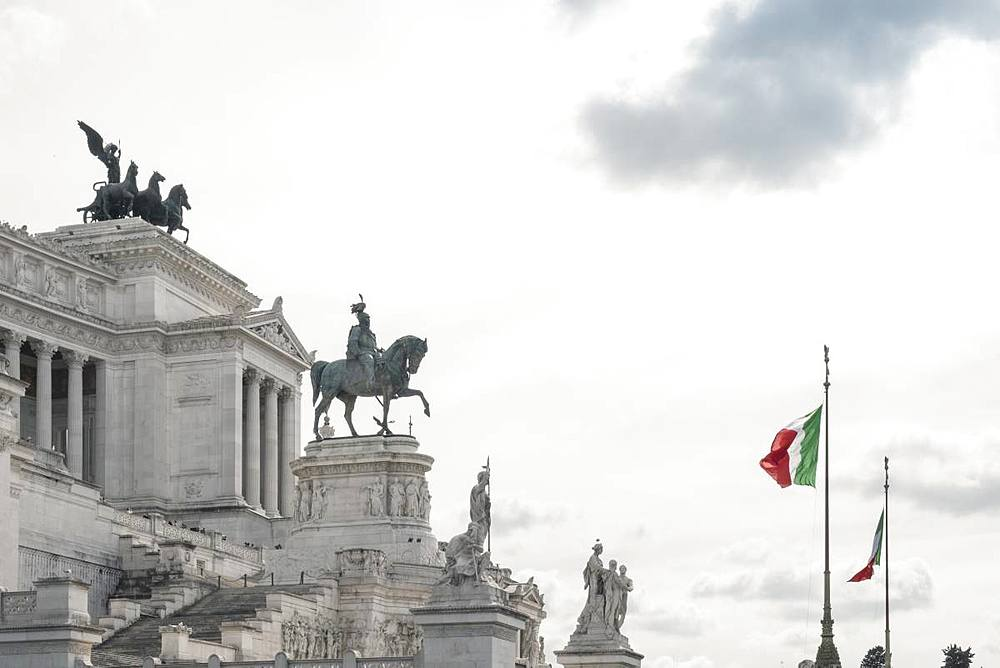 Italian flags flying over the Altare della Patria in the Piazza Venezia, Central Rome, Lazio, Italy, Europe