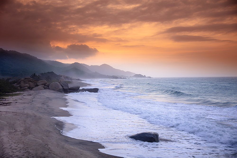 A deserted beach in Tayrona National Park under a golden sunset, Magdalena, Colombia, South America