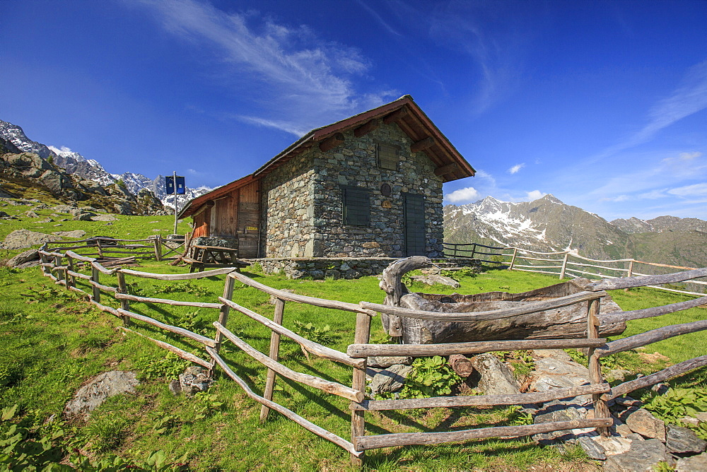 Green meadows and mountain hut on a summer sunny day, Orobie Alps, Arigna Valley, Sondrio, Valtellina, Lombardy, Italy, Europe