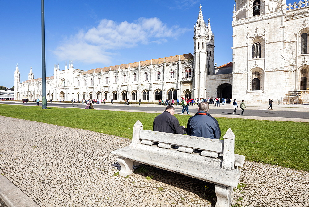 Tourists admire the late Gothic architecture of the Jeronimos Monastery, UNESCO World Heritage Site, Santa Maria de Belem, Lisbon, Portugal, Europe