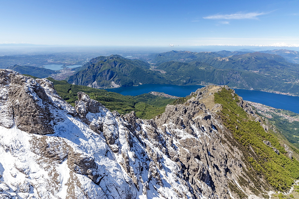 Aerial view of the snowy ridges of the Grignetta mountain with Lake Como in the background, Lecco Province, Lombardy, Italy, Europe
