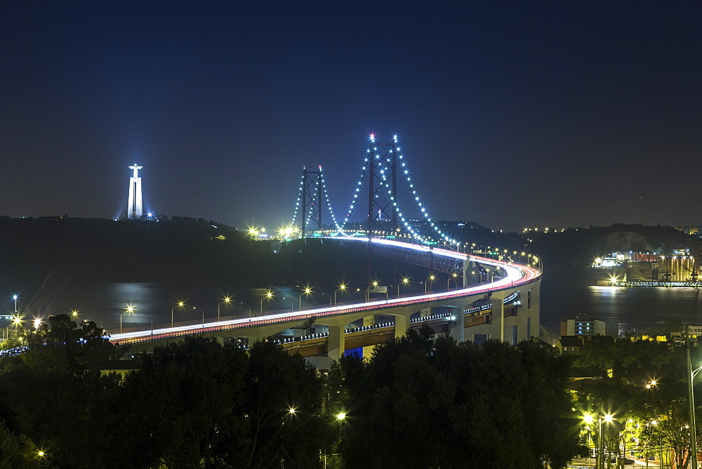 Night view of Ponte 25 de Abril, one of the largest suspension bridges in the world, Lisbon, Portugal, Europe