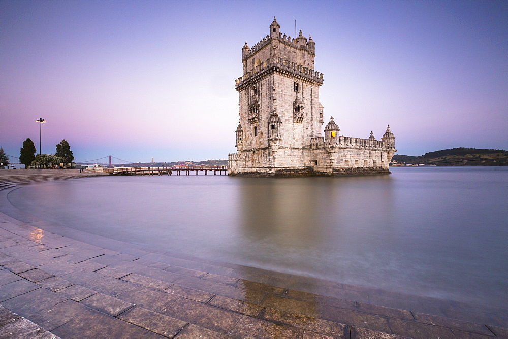 Colorful dusk on the Tower of Belem, UNESCO World Heritage Site, reflected in Tagus River, Belem, Lisbon, Portugal, Europe