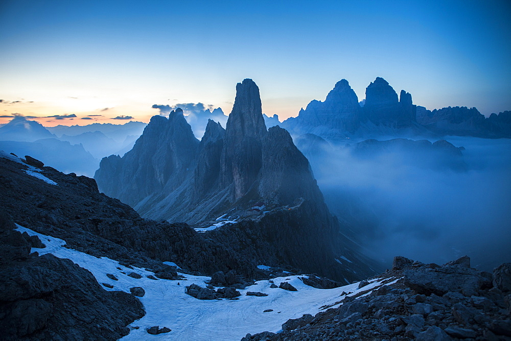 The Cadini di Misurina emerging from the fog after sunset, in a typical Dolomitic landscape, Dolomites, South Tyrol, Italy, Europe - 1179-112