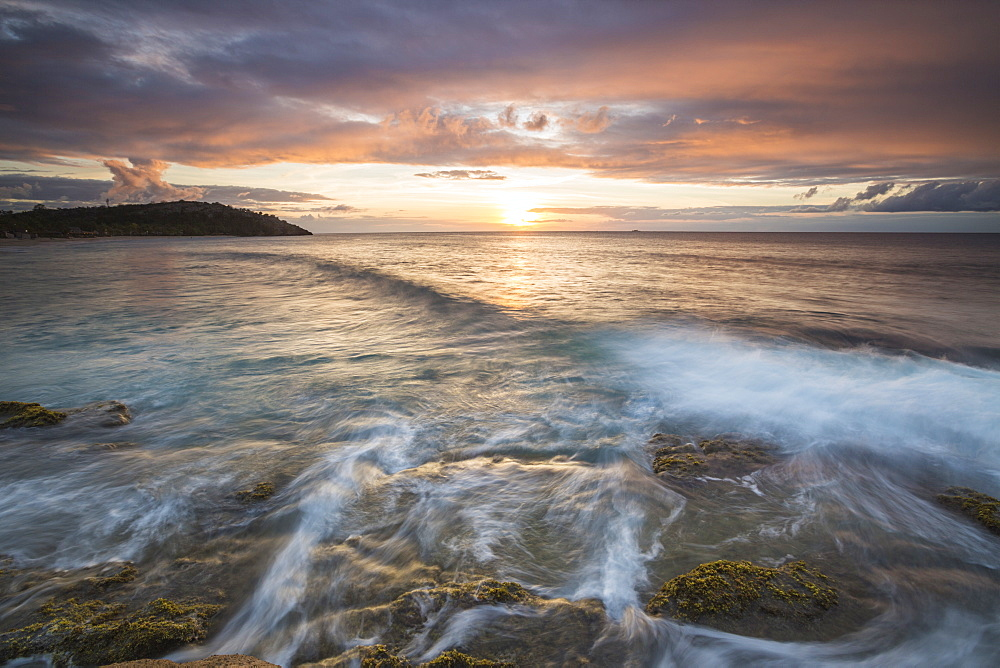 Waves crash on cliffs under a colorful Caribbean sunset, Galley Bay, St. John's, Antigua, Antigua and Barbuda, Leeward Islands, West Indies, Caribbean, Central America